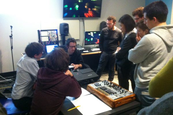 Visiting artist Ezra Buchla presents his work to students in the ESP Forum in the Spring of 2015