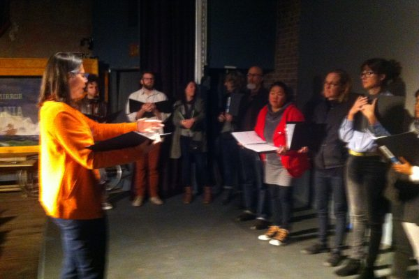 Sara Roberts directing the Readers Chorus in Los Angeles in the Spring of 2015